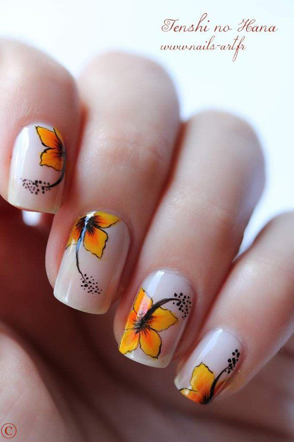 When it comes to summer, the hibiscus flower never ceases to disappear from the theme. This beautiful nail art design focuses on the pretty hibiscus flowers that represent summertime. Coated in a plain white background, petals of a yellow orange hibiscus flower is drawn on top as if to single out its beauty as simple as possible on the nails. Very clean and attractive look.