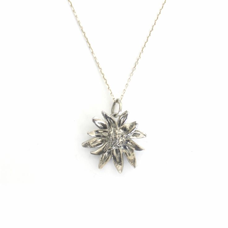 Designer Silver African Daisy Pendant by Beryl Dingemans £133 available exclusively in store at PinstripeandPearls.com - Sterling silver African daisy pendant, ethically produced.