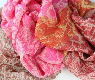 Ikat Wool Scarf in Lipstick Pink, with terracotta and tangerine orange tones. 100% fine wool, handwoven. $89 from the Juniper Hearth e-Emporium.