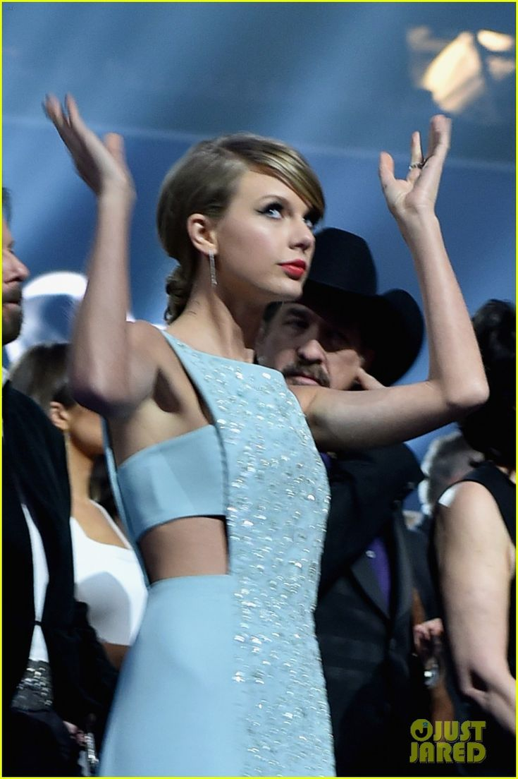 Taylor Swift dances away at her seat while in the audience of the 2015 Academy of Country Music Awards held at AT&T Stadium on Sunday (April 19)