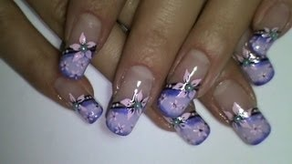 Purple nails with pink flower video nail art tutorial, via YouTube.