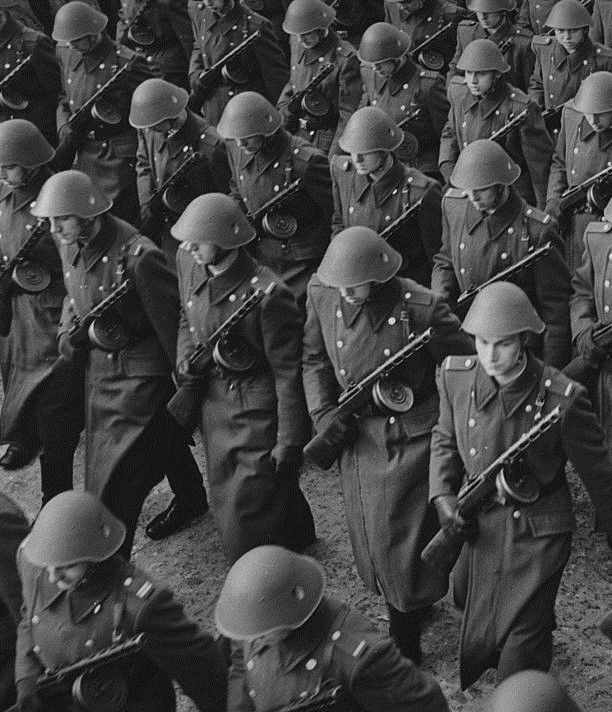 East German soldiers armed with PPSh-41 submachine guns.