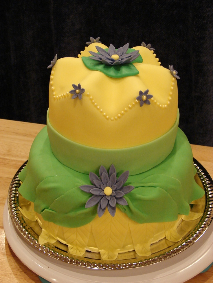 Princess and the Frog Birthday Cake - Princess and the frog themed cake for a little girl turning 10 at local shelter.  Bottom tier is meant to look like her dress, and the top tier is carved cake to look like her crown, with a lily pad/flower on top.  This was loads of fun to make.  Thanks for looking!
