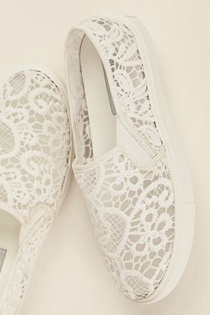 Dance the night away in comfort and style in this on-trend Steve Madden bridal lace slip on sneaker!  This bridal slip on sneaker showcases a gorgeous floral lace detail, providing both style and comfort!  Heel height: Flat.  Fully lined.  Imported.