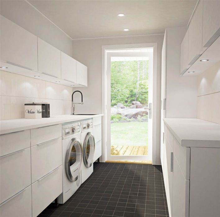 white laundry with dark grey tiled floor #laundry