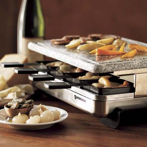 Electric Raclette Maker - Like its close relative fondue, raclette is meant for sharing, so it's an ideal menu item for casual dining. This handsome electric raclette maker comes with all the equipment required for eight guests to broil individual portions of cheese.