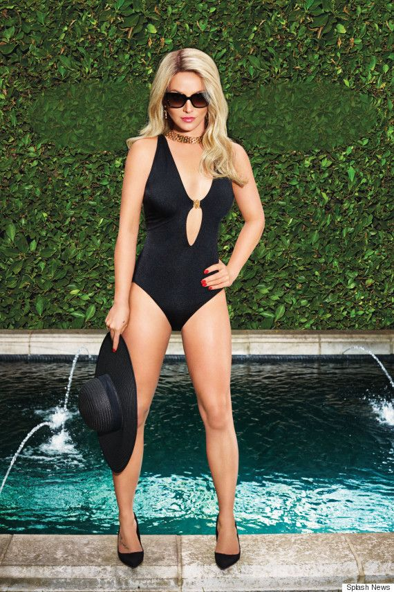 Britney Spears is living the glam life in this cutout black swimsuit