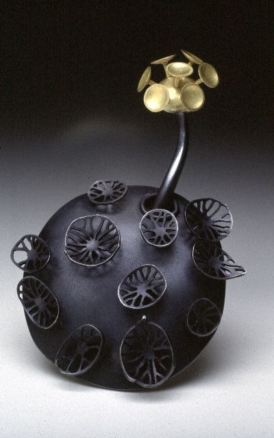 Sarah Parker Eaton, plankton-inspired jewelry designs. [According to the artist's website, this piece is a necklace. I don't see it, but there you have it...]