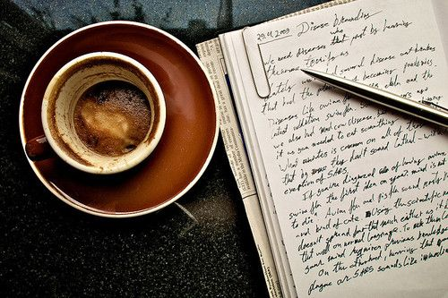 writing with a cup of coffee