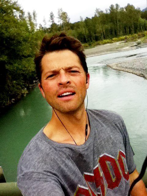 Misha Collins! God I love this picture so much. That's so hot HE IS WEARING A AC/DC SHIRT!!!