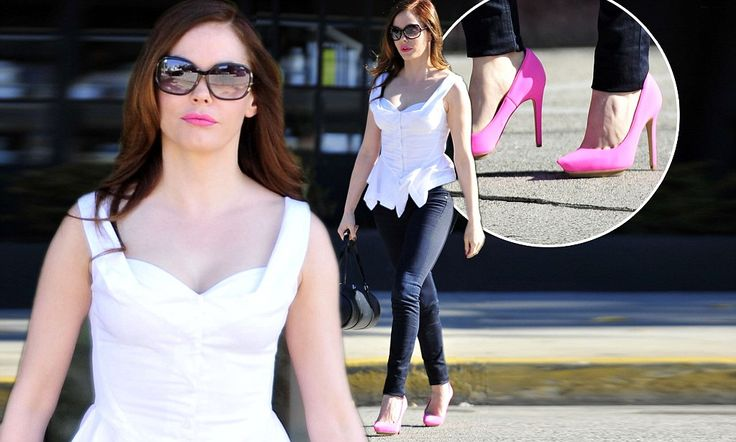 She's electric! Rose McGowan puts her best foot forward in neon pink heels