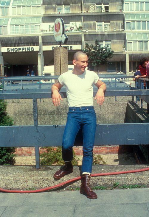 A Teenage Skinhead Boy Wearing Doc Marten Boots Standing