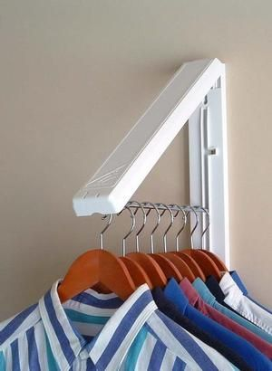 """Collapsible wall mounted clothes storage system creates 12"""" of hanging space & holds up to 50 lbs! Weather resistant for out door use. $14.95"""
