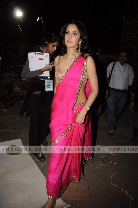 Katrina Kaif wearing a stunning nude blouse with a summer pink sari.