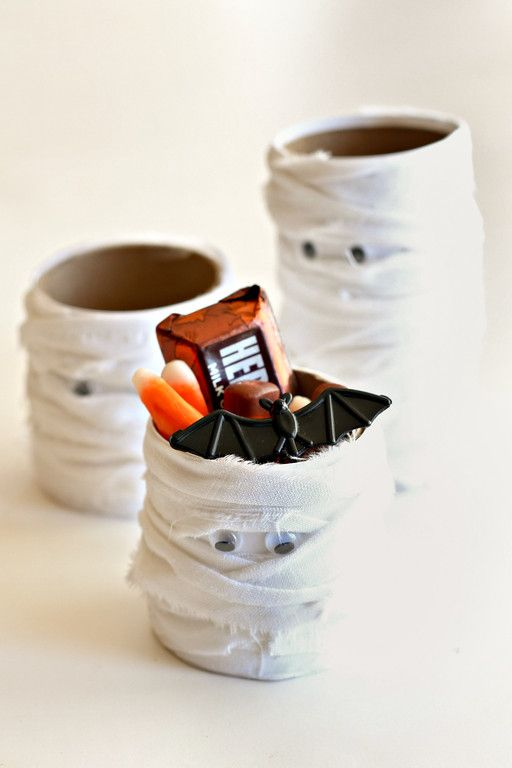 Easy Mummy Halloween Craft - think I'll try these with empty cans instead of toilet paper tubes!