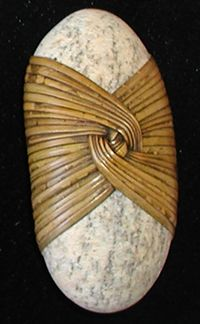 Deloss Webber. I have been finding more and more of these stones swaddled in basketry or leather- wanna try- j