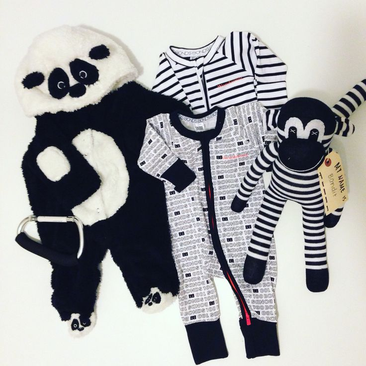 Baby flat lay, black and white theme, panda, bonds onesie, sock monkey