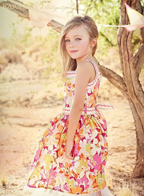 Love the warm, summery, timeless hues and soothing light at work in this beautiful image. #photography #photos #kids #orange #summer #beautiful #shoot #outdoors #dress #sundress #floral #pink #girl