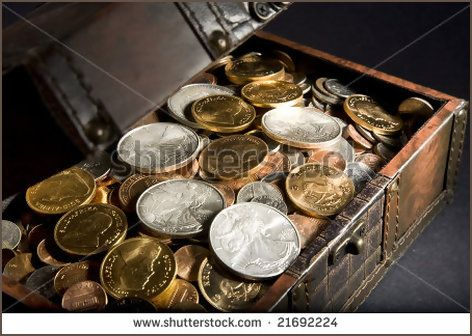Treasure Chest filled with gold Krugerrand coins from  South Africa, silver Walking Liberty coins from the  United States of America and assorted change - Shutterstock
