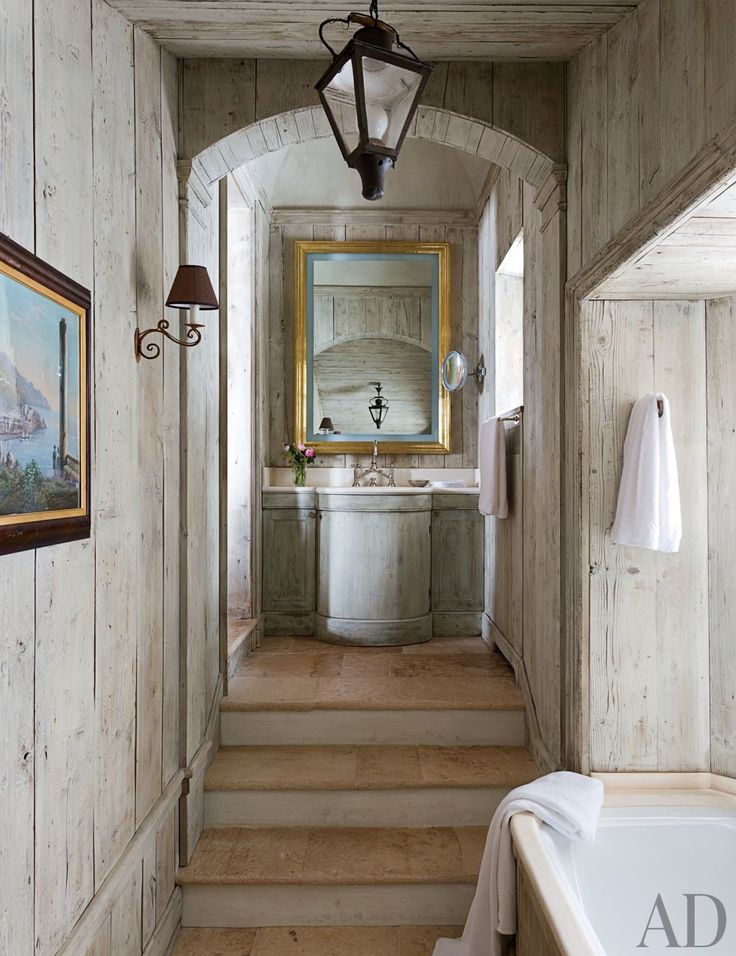 Pale reclaimed wood lines a bath in a Saint Moritz, Switzerland, home.