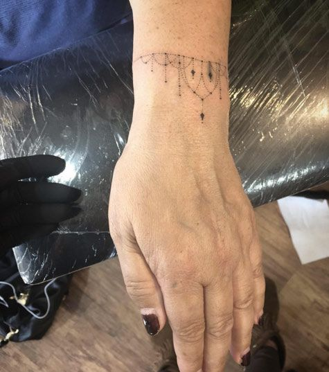 Hand Poked Bracelet Tattoo by Goldy