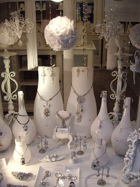 Great use of bottles and vases for jewelry display.