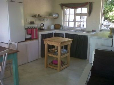 HR05Pan(150)  South Africa, Western Cape, Suiderstrand  ZAR 400 - ZAR 550 | 5 Sleeps | 3 Bedrooms | 2 Baths  Rustic little cottage with interesting accommodation. Private sheltered braai area - kuierplek. Main bedroom with bathroom (shower) next door; two single bed loft room onto huge sundeck with good sea views. Also tiny separate hut with ¾ bed, en-suite bathroom (Victorian bath) and mini kitchen (kettle and micro wave).