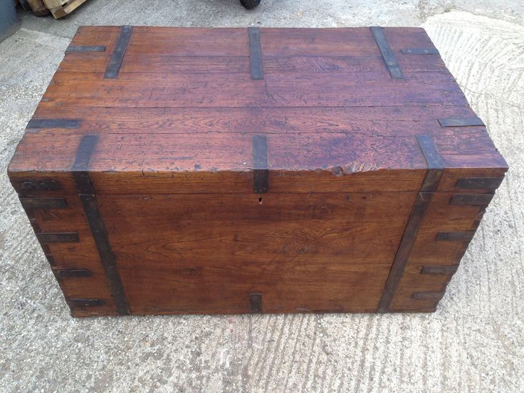 Large 4ft long teak trunk with steal straps around the carcass