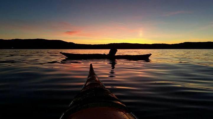 kajakk i solnedgang