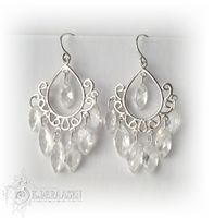 Romantic chandelier earrings, sterling silver and cubic zirconia.