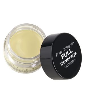 To conceal purple and blue under-eye circles, opt for a creamy, dense formula with a yellow or orange tint. For yellow, try NYX Concealer in a Jar in Yellow and for orange, try MAC Studio Finish Skin Corrector in Pure Orange. Use the concealer to create a downward pointing triangle under your eyes, with the point ending right in the middle of the apple of your cheeks. Blend it completely (you can go outside the triangle), and then apply your foundation.