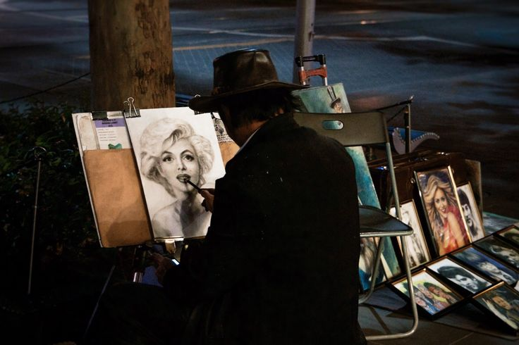 An artist painting a portrait of Marilyn Monroe on the streets of Melbourne Australia. Taken with my Canon T4i long exposure with 24-105mm lens. See more: http://lostboymemoirs.com/why-you-should-explore-melbourne-by-night/  Why You Should Explore Melbourne by Night - Lost Boy Memoirs | Travel and Adventure Blog