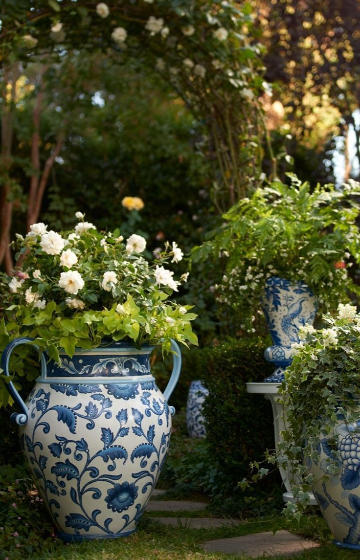 Our Blue and White Painted Tabletop Planter is an indulgence in ornate foliage, exotic birds and ceramic tile designed artistry.   Frontgate: Live Beautifully Outdoors