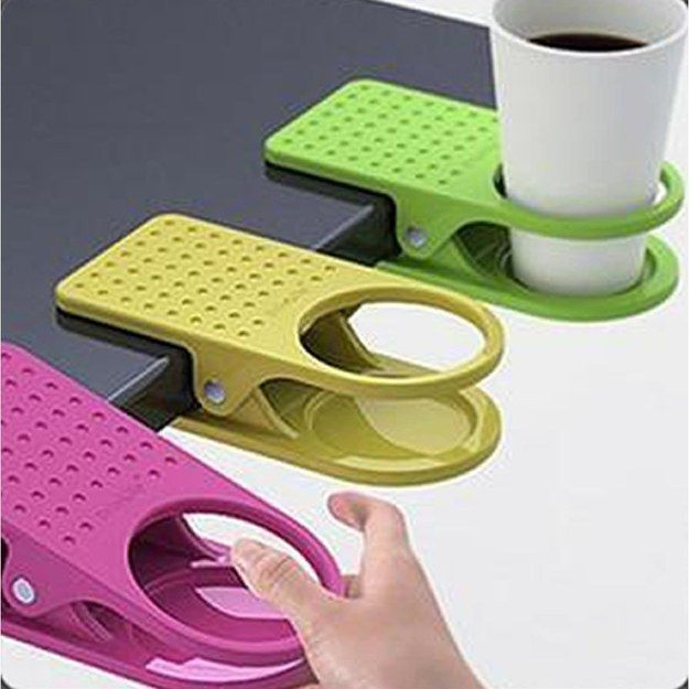 A clip that secures a cup holder to your desk. | 22 Ingenious Products That Will Make Your Workday So Much Better