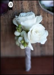 white snowberry and spray rose boutonniere wrapped with silver ribbon