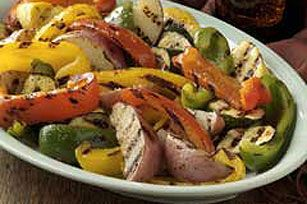 Simply Sensational Grilled Vegetables recipe - Grilling peppers, squash, and whatever other veggies you love over medium heat keeps the delicious factor high. Add zesty dressing and you've got a super-easy, smart side. #kraftrecipes