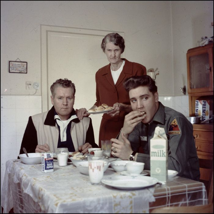 Minnie Mae, center, serves her son, Vernon, and her grandson, Elvis, who at the…