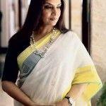 Shabana Azmi in a white cotton saree with yellow border