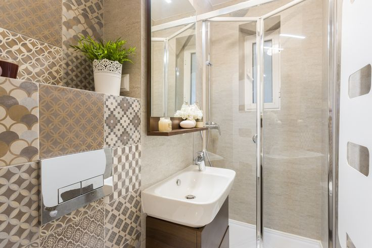 Small bath design, ceramic tiles from Delta Studio Design, with brown patterns.