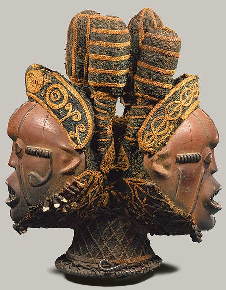 Africa | Janus faced Headdress from the Boki people of Nigeria | Wood, cotton, metal, cane and pigment | 19th - 20th century.