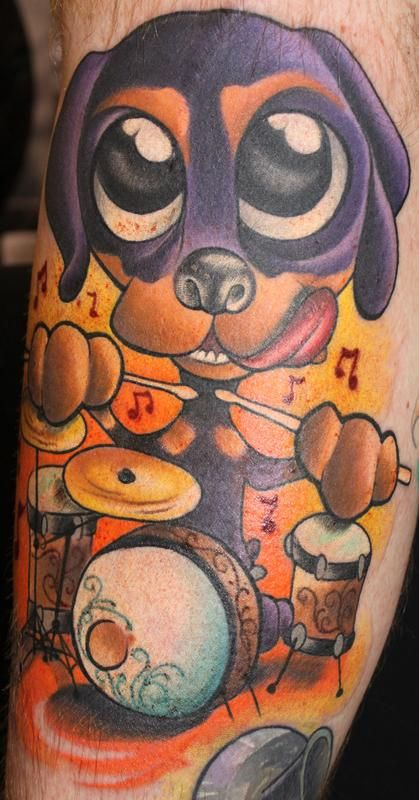 Image result for drummers with calf tattoos of puppies