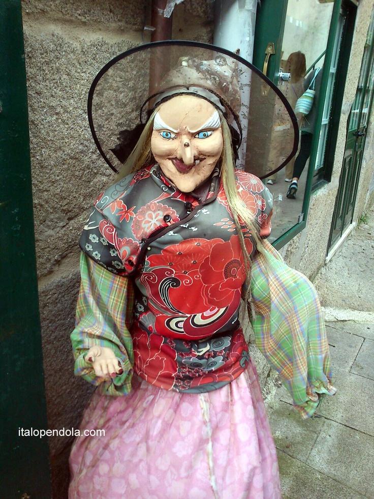 A 'Meiga' in one street of Combarro, Galicia