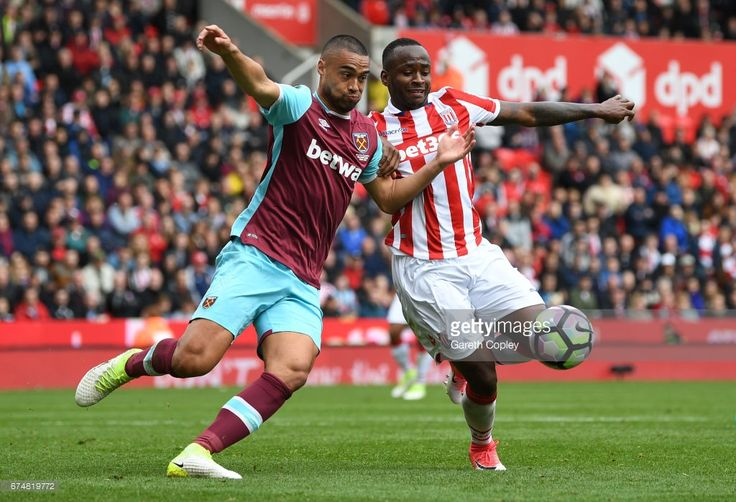 Saido Berahino of Stoke City and Winston Reid of West Ham United clash  during the Premier League match between Stoke City and West Ham United at Bet365 Stadium on April 29, 2017 in Stoke on Trent, England.  (Photo by Gareth Copley/Getty Images)