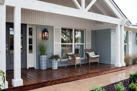 Other exterior upgrades include a new roof, new windows with Bahama style shutters,  and, most notably, a dramatic front porch with white columns and post-and-beam style overhang.