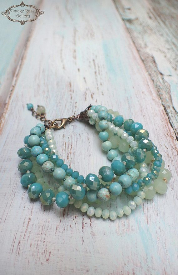 Turquoise Boho Chic Bracelet, Aqua Multi Strand Bracelet, Aqua Beaded Bracelet, Sea Foam Bracelet A gorgeous , One of a kind , 6 strand bracelet with soft Green shades . Features opalescent light green glass , different shades of mint green and turquoise crystal beads and #seaglassbracelet