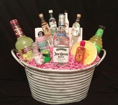 'Drunk in Love' Basket for Bridal Shower Chinese Auction  Includes 3 piece shaker set, 4 shot glasses, margarita salt, lime juice, a bottle of Jose Cuervo, and an array of mixers and shot size bottles of alcohol.