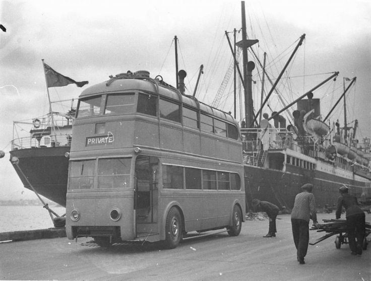 Trolley bus being unloaded from ship from England in Sydney, 1930s