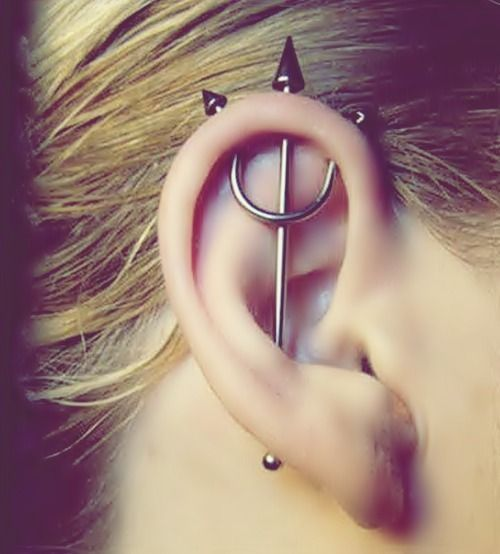 haha so awesome pitch fork triple cartilage ear piercing