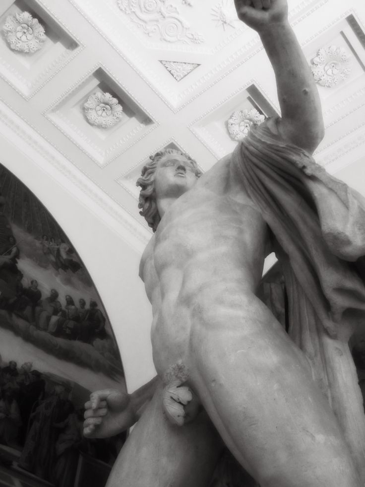 A dramatic upshot of a statue in the Museum of Artists, Saint Petersburg, Russia