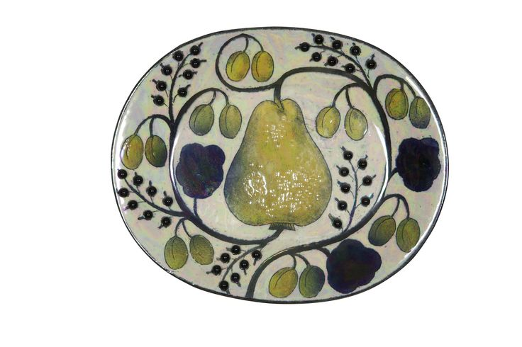 Birger Kaipiainen Decorative Dish, sign., 1970s-80s, faience, irdescent glaze and ceramic pearls, painted with a pear, lilies-of-the valley and prunes, length 44 cm